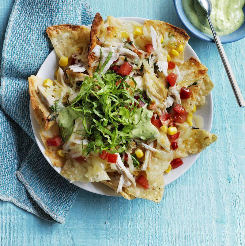 """<p>Combining avocado with sour cream and lime juice creates a creamy dressing for your nachos.</p><p><em><u><a href=""""https://www.womansday.com/food-recipes/food-drinks/recipes/a54433/loaded-chicken-nachos-recipe/"""" rel=""""nofollow noopener"""" target=""""_blank"""" data-ylk=""""slk:Get the recipe for Loaded Chicken Nachos."""" class=""""link rapid-noclick-resp"""">Get the recipe for Loaded Chicken Nachos.</a></u></em></p>"""