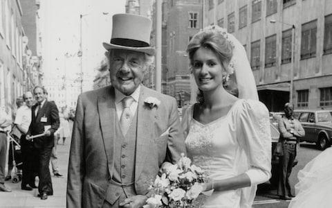Lady Cowdray with her father, former MP John Cordle, on her wedding day - Credit: Steve Back/ANL/REX