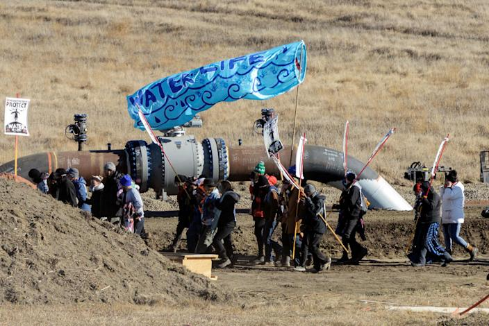 <p>Protesters march along the pipeline route during a protest against the Dakota Access pipeline near the Standing Rock Indian Reservation in St. Anthony, North Dakota, U.S. November 11, 2016. (Photo: Stephanie Keith/Reuters) </p>