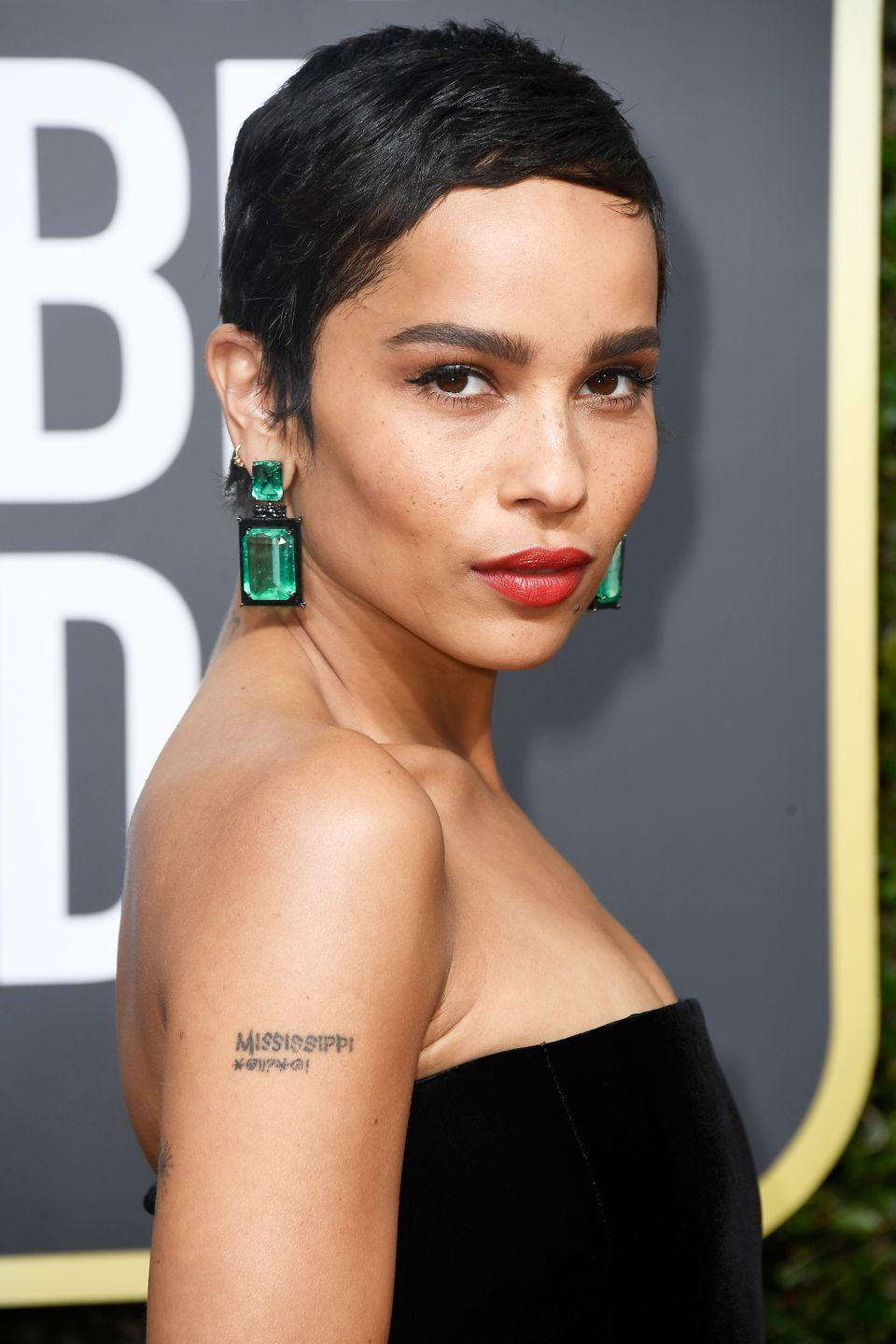 """<p>Perhaps this is one of the most daring cuts amongst the bunch, but actress <strong>Zoe Kravitz</strong> makes this very short crop look edgy, cool and super chic. For a smooth look without shine or crunch from a <a href=""""https://www.goodhousekeeping.com/beauty-products/g33809765/best-gel-for-curly-hair/"""" rel=""""nofollow noopener"""" target=""""_blank"""" data-ylk=""""slk:hair gel"""" class=""""link rapid-noclick-resp"""">hair gel</a>, try wrapping your hair with a <a href=""""https://www.goodhousekeeping.com/uk/fashion-beauty/hair-advice/a32014757/silk-hair-wrap/"""" rel=""""nofollow noopener"""" target=""""_blank"""" data-ylk=""""slk:silk or satin scarf"""" class=""""link rapid-noclick-resp"""">silk or satin scarf</a> overnight to keep your hair in place.<strong><br></strong></p>"""
