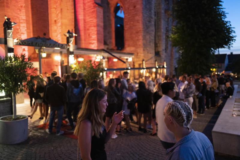 People stand in line without social distancing outside a restaurant in Gotland, Sweden. (Martin von Krogh/Getty Images)