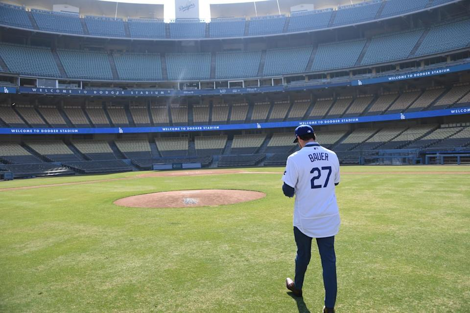 Trevor Bauer walks to the pitcher's mound during his introductory news conference at Dodger Stadium on Thursday.