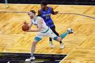 Charlotte Hornets forward Gordon Hayward, left, drives past Orlando Magic guard Terrence Ross (31) during the second half of an NBA basketball game, Sunday, Jan. 24, 2021, in Orlando, Fla. (AP Photo/John Raoux)