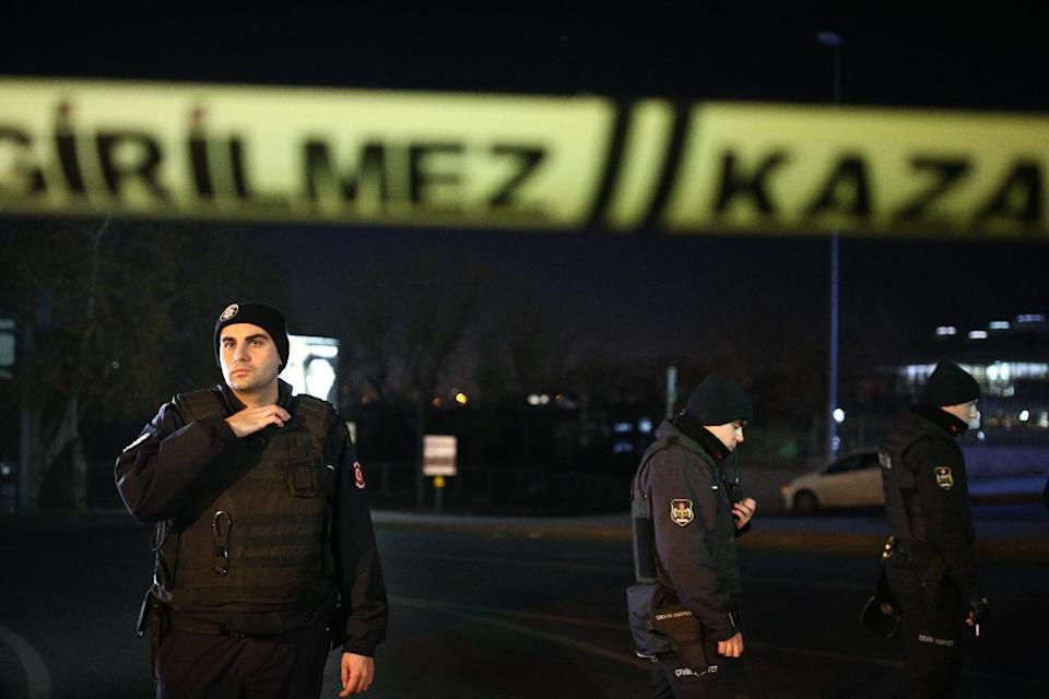 Turkish police officer cordon off the roads leading to the area of the Besiktas football club stadium, in Istanbul, late Saturday, Dec. 10, 2016. Two loud explosions have been heard near the newly built soccer stadium and witnesses at the scene said gunfire could be heard in what appeared to have been an armed attack on police. Turkish authorities have banned distribution of images relating to the Istanbul explosions within Turkey. (AP Photo/Emrah Gurel) TURKEY OUT