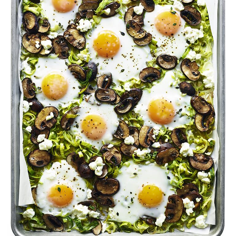 """<p>Enjoy this dish hot from the oven, with crusty bread to soak up the runny yolks. For firmer yolks and whites, leave the eggs on the rimmed baking sheet for 4 to 5 minutes before serving.</p> <p><a href=""""https://www.myrecipes.com/recipe/baked-eggs-leeks-mushrooms"""">Baked Eggs with Leeks and Mushrooms Recipe</a></p>"""