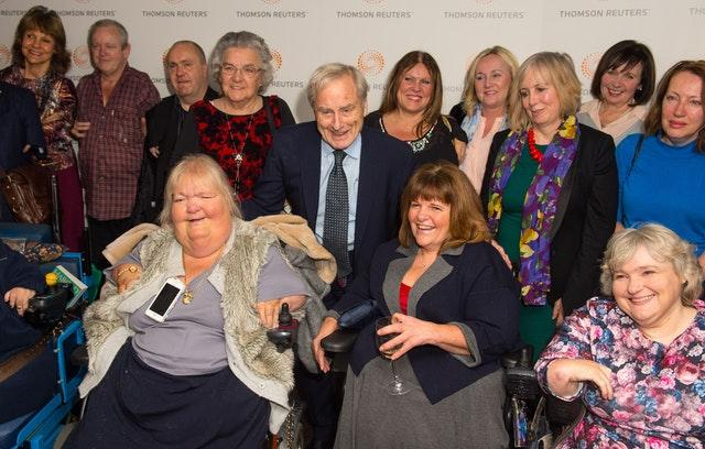 Sir Harold Evans with a group of thalidomide victims at the premiere of Attacking The Devil