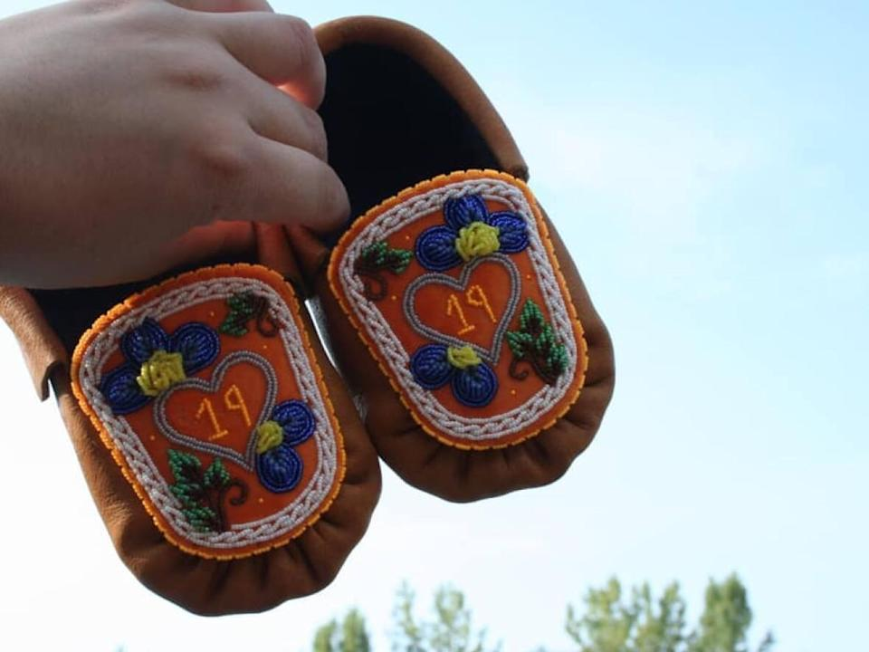 Kawisaiénhne Albany made these moccasins for her great-great-uncle Ernest Nicholas, who never returned home from the Shingwauk residential school in Sault Saint Marie, Ont.  (Submitted by Kawisaiénhne Albany - image credit)
