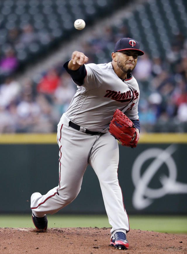 Minnesota Twins starting pitcher Fernando Romero throws to a Seattle Mariners batter during the first inning of a baseball game Friday, May 25, 2018, in Seattle. (AP Photo/Elaine Thompson)