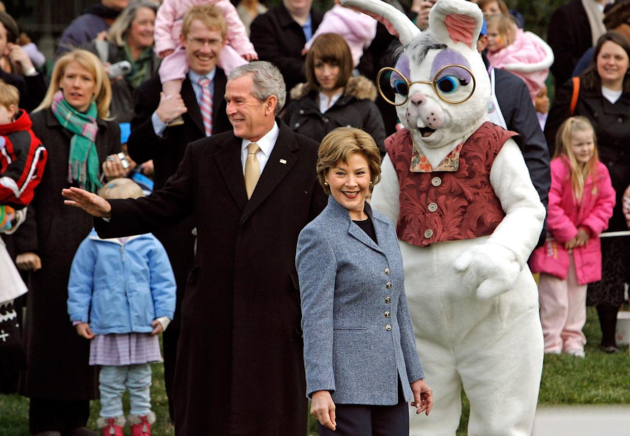 President Bush and first lady Laura Bush stand with the Easter Bunny while welcoming guests in 2008.