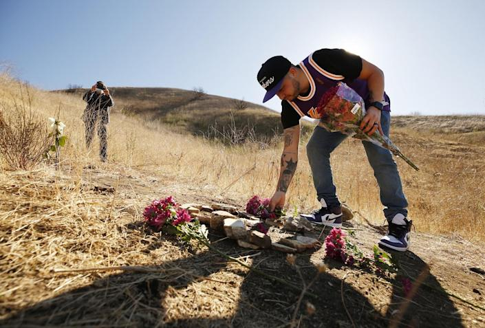 Anthony Calderon, 33, brought flowers and arranged rocks in a figure 8 on the mountainside in Calabasas.