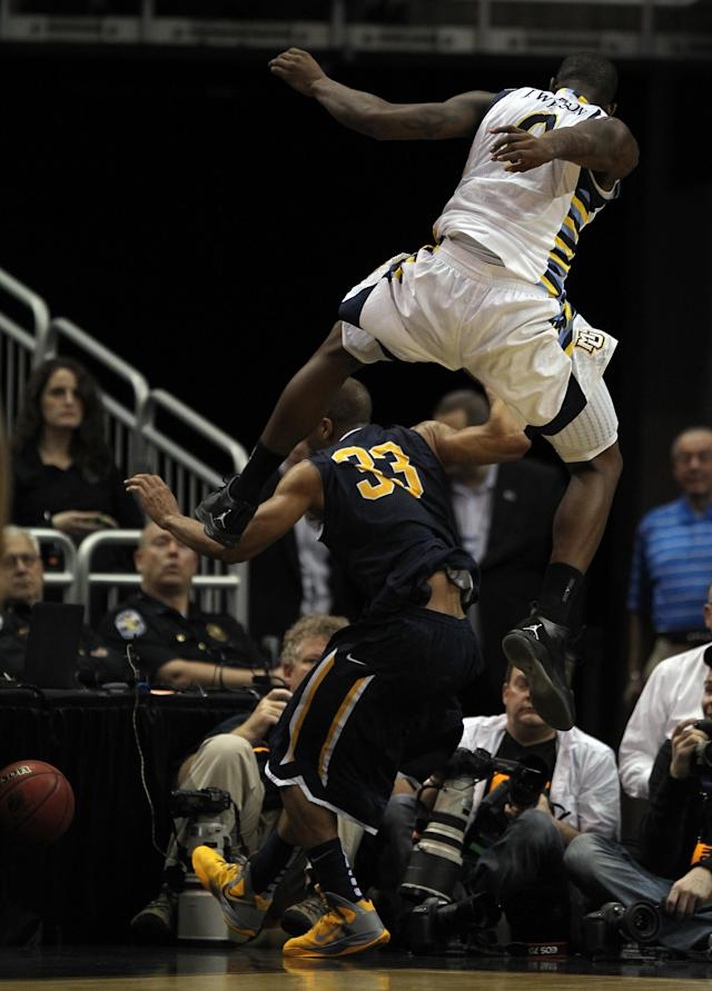 LOUISVILLE, KY - MARCH 17: Jamil Wilson #0 of the Marquette Golden Eagles leaps over Jewuan Long #33 of the Murray State Racers as the ball goes out of bounds in the first half during the third round of the 2012 NCAA Men's Basketball Tournament at KFC YUM! Center on March 15, 2012 in Louisville, Kentucky. (Photo by Jonathan Daniel/Getty Images)