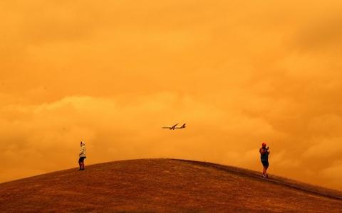 <span>New Zealand skies are affected by fires thousands of miles away</span> <span>Credit: PHIL WALTER/GETTY </span>
