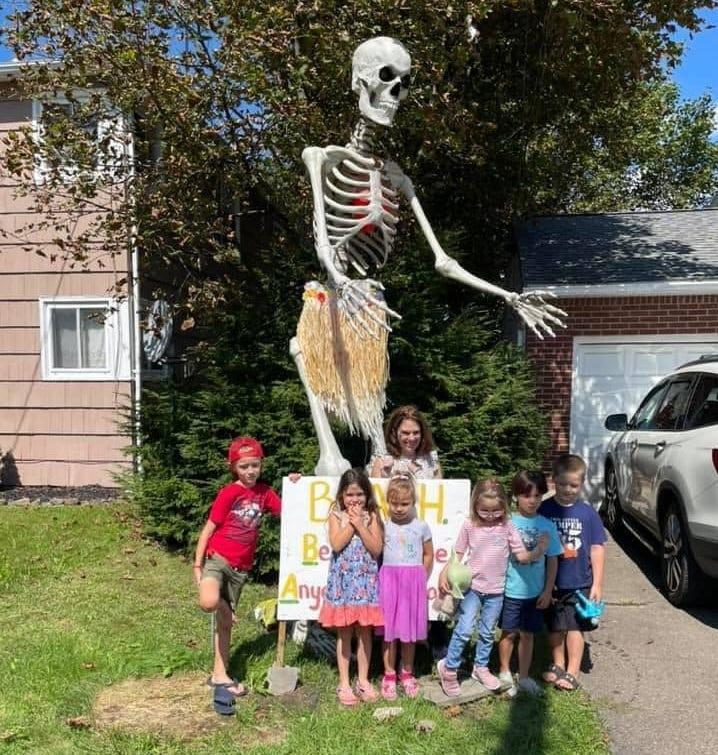 Boris the Skeleton poses with some young fans from Binghamton's Horace Mann Elementary School. A physical education teacher at the school, Ed Gee, saved Scott Varcadipane's life last year. Now Varcadipane and his fiancée, Samantha Dalla-Varde, use the skeleton to help raise money for charitable causes including school supplies for the school.
