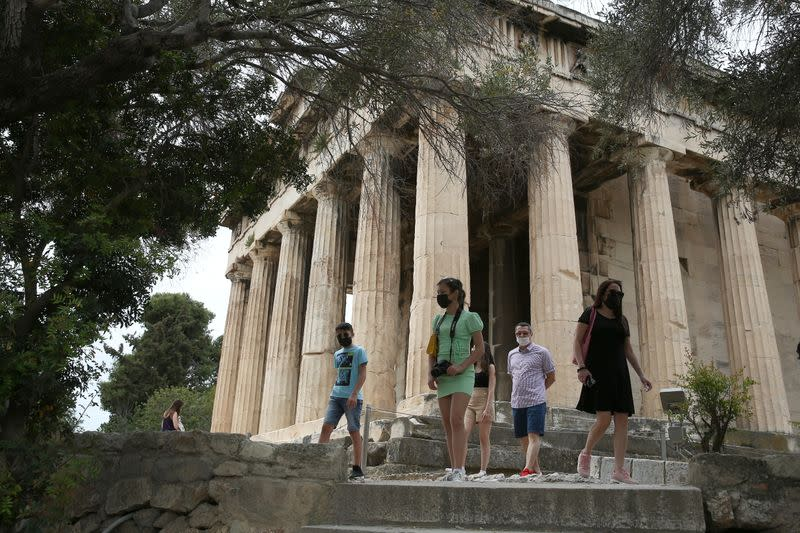 Tourists visit ancient temple of Hephaestus in Athens