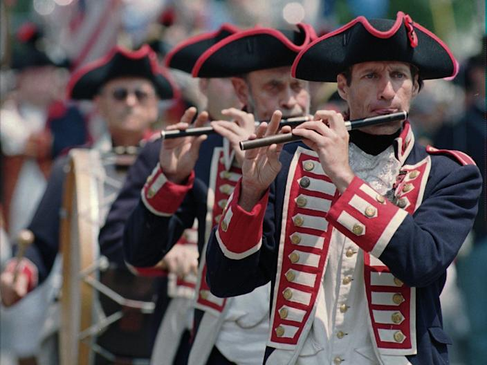 Members of the East Greenwich, Rhode Island, Kentish Guards perform during the Bristol, Rhode Island, Independence Day Parade in 1996.
