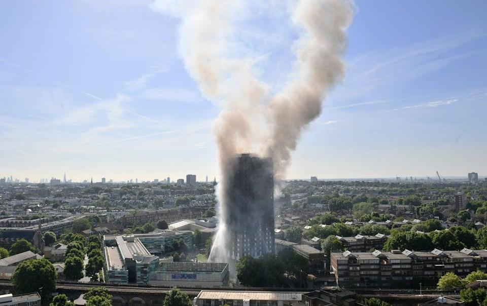Smoke continues to billow out of the tower block on the day of the blaze in June 2017 (PA) (PA Wire)