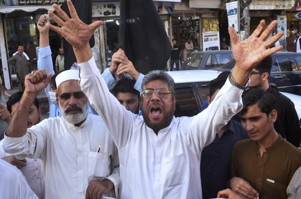 Pakistan traders chant anti-French slogans against the publishing of caricatures of the Prophet Muhammad they deem blasphemous, in Peshawar, Pakistan, Monday, Oct. 26, 2020. Pakistan's Prime Minister Imran Khan said the French leader chose to encourage anti-Muslim sentiment and deliberately provoke Muslims by encouraging the display of blasphemous cartoons targeting Islam. (AP Photo/Muhammad Sajjad)