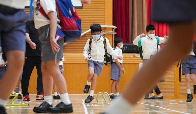 Staff at Ying Wa Primary School set up a mini-obstacle course for pupils on their first day back. Photo: Winson Wong