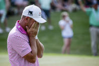 Alex Cejka, of Germany, reacts after Steve Stricker's missed putt in a playoff to win during the final round of the Regions Tradition Champions Tour golf tournament Sunday, May 9, 2021, in Hoover, Ala. (AP Photo/Butch Dill)