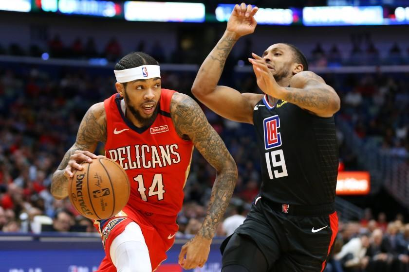 NEW ORLEANS, LOUISIANA - JANUARY 18: Brandon Ingram #14 of the New Orleans Pelicans drives against Rodney McGruder #19 of the LA Clippers during the first half at the Smoothie King Center on January 18, 2020 in New Orleans, Louisiana. NOTE TO USER: User expressly acknowledges and agrees that, by downloading and or using this Photograph, user is consenting to the terms and conditions of the Getty Images License Agreement. (Photo by Jonathan Bachman/Getty Images)