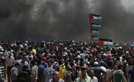 Dozens DEAD as troubles flare on Gaza border