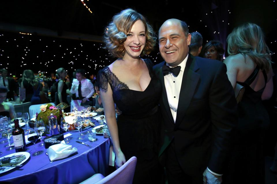 """""""Mad Men"""" creator Matthew Weiner (R) with """"Mad Men"""" actress Christina Hendricks pose at the Governors Ball for the 65th Primetime Emmy Awards in Los Angeles September 22, 2013. REUTERS/Mario Anzuoni"""