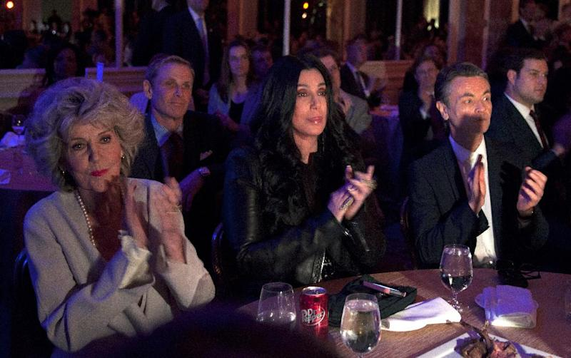 Cher looks the the stage and applauds as President Barack Obama speaks at a campaign event at the Beverly Wilshire Hotel, Wednesday, June 6, 2012, in Los Angeles. (AP Photo/Carolyn Kaster)