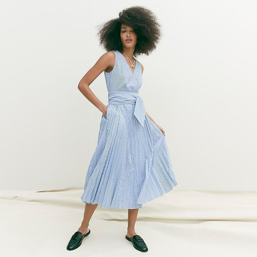 """<br><br><strong>J.Crew</strong> Pleated V-neck dress in stripe, $, available at <a href=""""https://go.skimresources.com/?id=30283X879131&url=https%3A%2F%2Fwww.jcrew.com%2Fp%2Fwomens%2Fcategories%2Fclothing%2Fdresses-and-jumpsuits%2Fpleated-v-neck-dress-in-stripe%2FAW796%3Fdisplay%3Dsale%26fit%3DClassic%26isFromSale%3Dtrue%26color_name%3Dblue-white%26colorProductCode%3DAW796"""" rel=""""nofollow noopener"""" target=""""_blank"""" data-ylk=""""slk:J. Crew"""" class=""""link rapid-noclick-resp"""">J. Crew</a>"""