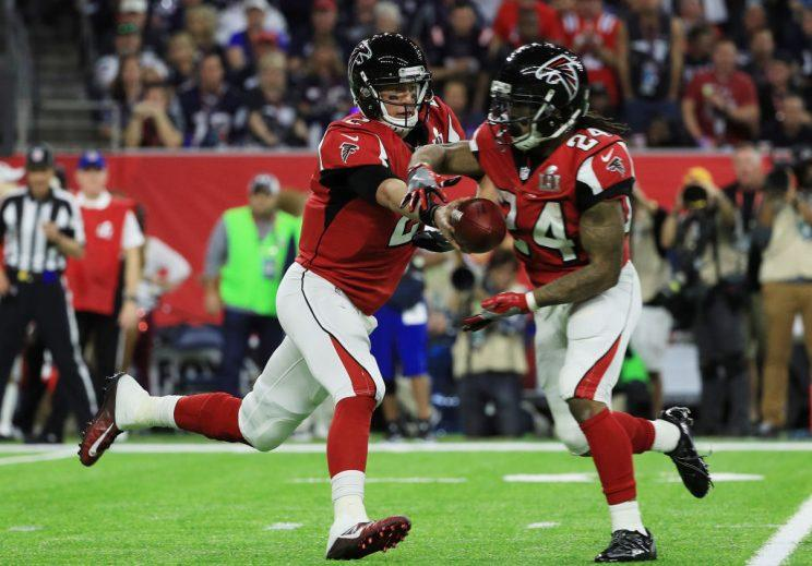 Matt Ryan and Devonta Freeman, connecting again. (Getty)