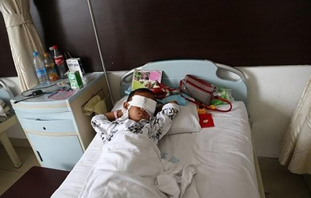 China police suspects late aunt responsible for gouging the eyes of six-year-old boy. (AFP photo)