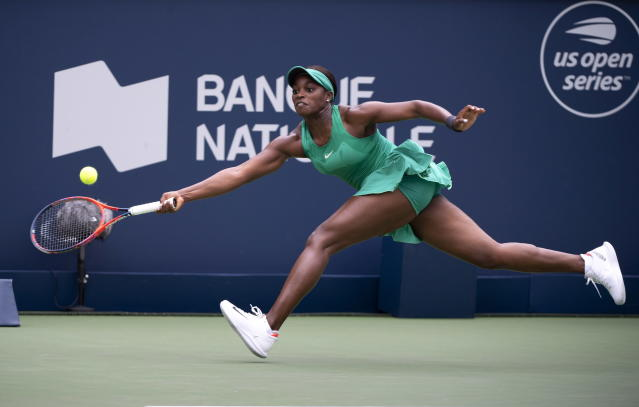 Sloane Stephens, of the United States, lunges to return to Francoise Abanda, of Canada, during the Rogers Cup women's tennis tournament, Wednesday, Aug. 8, 2018, in Montreal. (Paul Chiasson/The Canadian Press via AP)