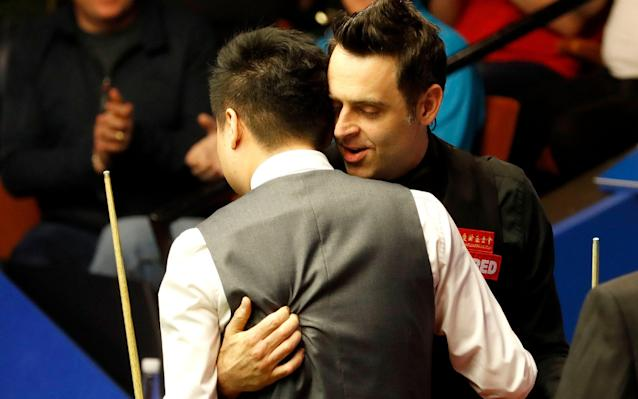 <span>Ronnie O'Sullivan (right) congratulates Ding Junhui</span> <span>Credit: PA </span>