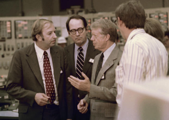 FILE - In this April 1, 1979, file photo President Jimmy Carter talks in the control room of Three Mile Island nuclear plant in Middletown, Pa., with from left, Harold Denton, Director of the U.S. Nuclear Agency, Pennsylvania Gov. Dick Thornburgh, and an unidentified control room employee. Thornburgh died Thursday, Dec. 31, 2020 at a retirement community facility outside Pittsburgh, his son David said. (AP Photo, File)