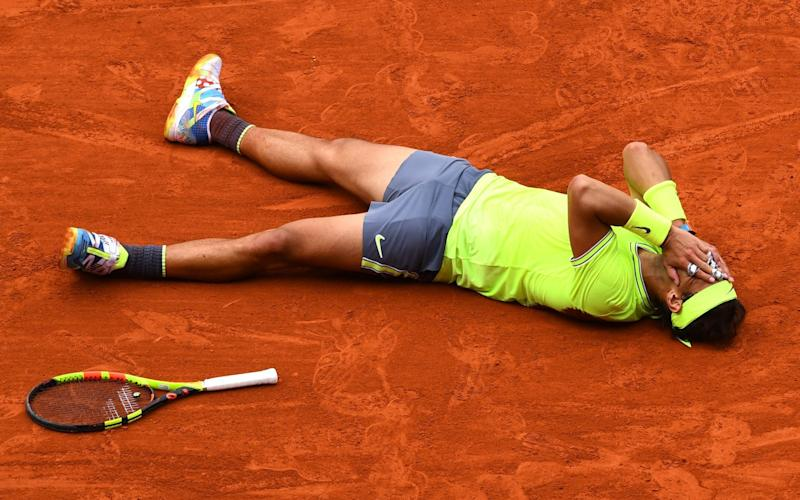 Roger Federer celebrates winning his 12th French Open title on Sunday - Getty Images Europe