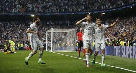 Real Madrid's Cristiano Ronaldo celebrates scoring their third goal with team mates