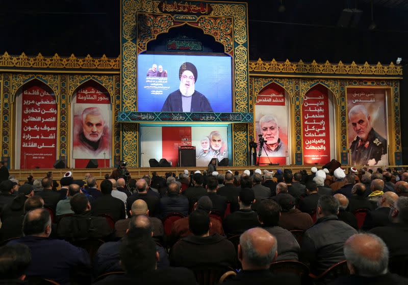 Lebanon's Hezbollah leader Sayyed Hassan Nasrallah addresses his supporters via a screen during a funeral ceremony rally to mourn Qassem Soleimani, head of the elite Quds Force, who was killed in an air strike at Baghdad airport, in Beirut's suburb