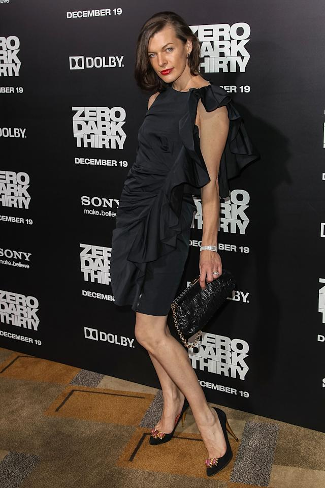 """HOLLYWOOD, CA - DECEMBER 10:  Actress Milla Jovovich arrives at the premiere of Columbia Pictures' """"Zero Dark Thirty"""" held at the Dolby Theatre on December 10, 2012 in Hollywood, California.  (Photo by Paul A. Hebert/Getty Images)"""