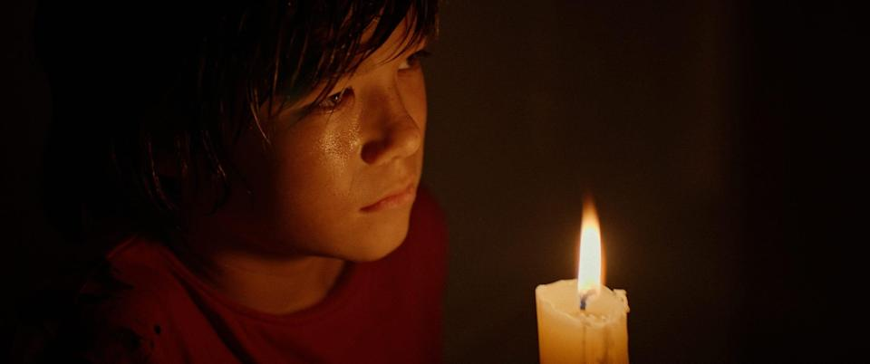 """Ezra Dewey stars as a mute 12-year-old grieving the loss of his mother, discovers a book of magic spells, performs a ritual to finally have a voice, and unleashes a sinister spirit in the horror film """"The Djinn."""""""