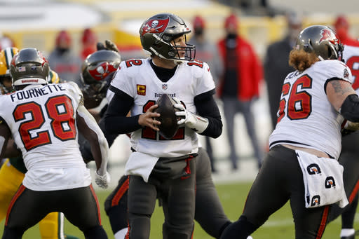 Tampa Bay Buccaneers quarterback Tom Brady (12) looks to pass against the Green Bay Packers during the first half of the NFC championship NFL football game in Green Bay, Wis., Sunday, Jan. 24, 2021. (AP Photo/Jeffrey Phelps)