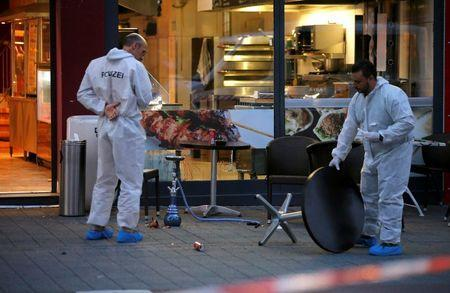 Police forensic experts work outside where a 21-year-old Syrian refugee killed a woman with a machete and injured two other people in the city of Reutlingen, Germany July 24, 2016. REUTERS/Vincent Kessler
