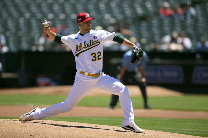 Oakland Athletics starting pitcher James Kaprielian (32) delivers against the Boston Red Sox during the first inning of a baseball game, Sunday, July 4, 2021, in Oakland, Calif. (AP Photo/D. Ross Cameron)