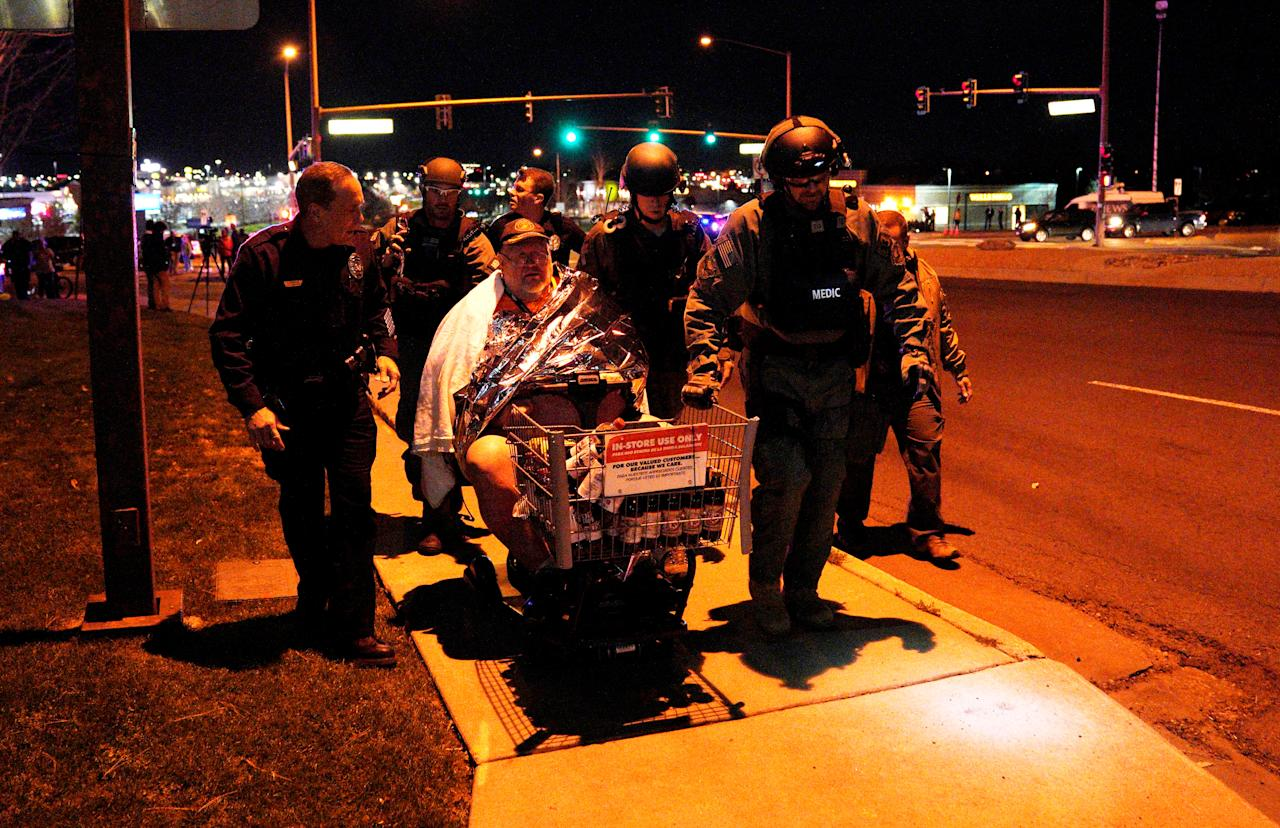 <p>Patrick Carnes is evacuated in a Walmart cart by SWAT medics from the scene of a shooting at a Walmart where Carnes was shopping in Thornton, Colo., Nov. 1, 2017. (Photo: Rick Wilking/Reuters) </p>