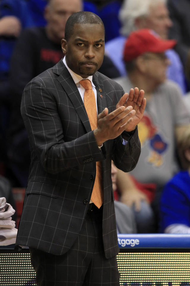 Oklahoma State head coach Mike Boynton applauds his team during the first half of an NCAA college basketball game against Kansas in Lawrence, Kan., Monday, Feb. 24, 2020. (AP Photo/Orlin Wagner)