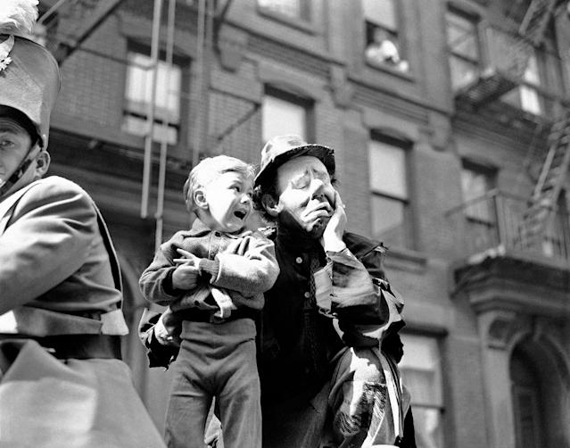 <p>Three-year-old Richard Caglione sheds tears as a stranger, in this case, Emmett Kelly, featured clown with Ringling Brothers and Barnum and Bailey Circus, picks him up during New York's first circus parade in 19 years on April 9, 1945, which launched the first phase of the Seventh War Loan Drive. (AP Photo/Anthony Camerano) </p>