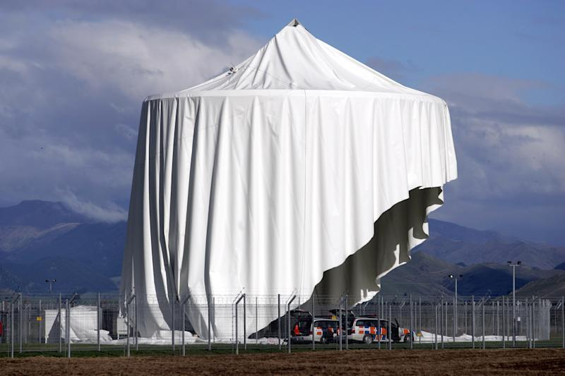 In this April 30 2008 photo, a damaged satellite communications dome is covered with a tent at Waihopai satellite communications interception station near Blenheim, New Zealand. Waihopai satellite communications is part of a surveillance spying alliance known as Five Eyes that groups together five English-speaking democracies - the U.S., Britain, Canada, Australia and New Zealand - collaboration that began during World War II when the allies were trying to crack German and Japanese naval codes and has endured for more than 70 years. (AP Photo/New Zealand Herald, Tim Cuff) NEW ZEALAND OUT, AUSTRALIA OUT
