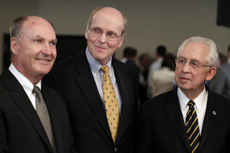 From left, Big Ten Commissioner Jim Delany, BCS executive director Bill Hancock and SEC Commissioner Mike Slive smile during an interview after a BCS presidential oversight committee meeting and media availability, Tuesday, June 26, 2012, in Washington. A committee of university presidents on Tuesday approved the BCS commissioners' plan for a four-team playoff to start in the 2014 season. (AP Photo/Alex Brandon)
