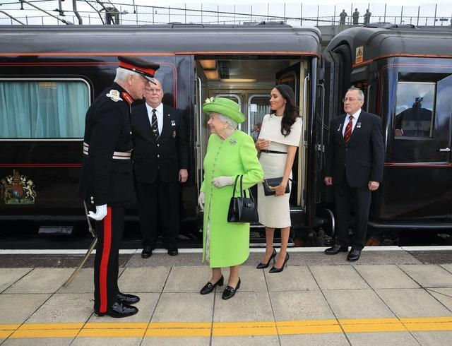 Queen and the Duchess of Sussex arrive by Royal Train at Runcorn Station to carry out engagements in Cheshire. Peter Byrne/PA Wire