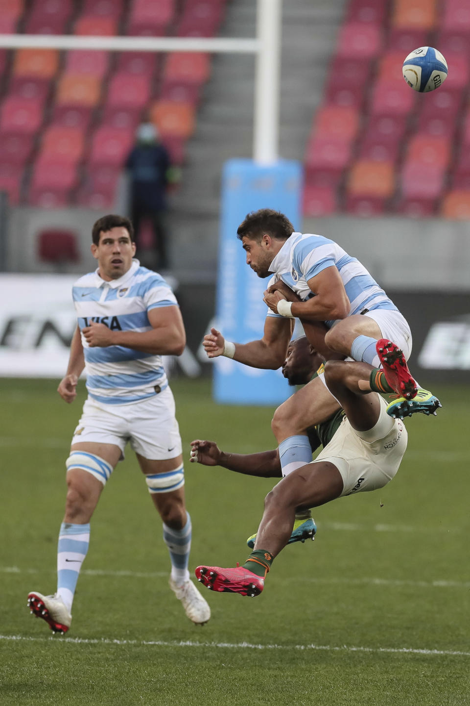 Lukhanyo Am of South Africa and Jeronimo de la Fuente of Argentina, right, collide for a high ball during the second Rugby Championship match between Argentina and South Africa at the Nelson Mandela Bay Stadium, Gqebeha, South Africa, Saturday, Aug. 21, 2021. (AP Photo/Halden Krog