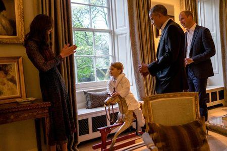 Handout photo issued by Kensington Palace of U.S. President Barack Obama (2nd right) and Britain's Prince William (right) while Catherine, Duchess of Cambridge plays with Prince George as he rides a rocking horse Friday April 22, 2016. Kensington Palace/PA Wire/Handout via Reuters