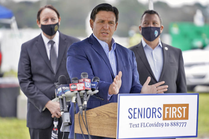 Florida Gov. Ron DeSantis speaks the media at a coronavirus vaccination site at Lakewood Ranch Wednesday, Feb. 17, 2021, in Bradenton, Fla. (AP Photo/Chris O'Meara)